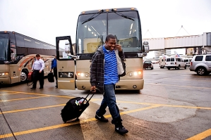 Seahawks running back Justin Forsett makes his way from the bus across the tarmac to the charter plane at SeaTac Internatioal Airport on Friday afternoon.