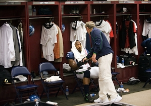 In the visitors locker room, head coach Pete Carroll paid a brief visit to linebacker Aaron Curry before the team took the field.