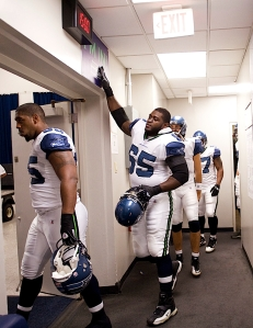 """Center Chris Spencer """"taps in"""" with the rest of the players as they head from the locker room to the field."""