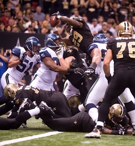 Linebacker Aaron Curry tried to meet New Orleans running back Chris Ivory at the top of the pile but the Saints scored to take a 7-3 lead.