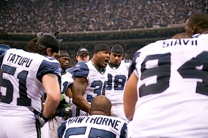 On the Seahawks sidelines, defensive captain Lawyer Milloy rallied his teammates.