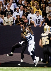 Cornerback Walter Thurmond makes a pass deflection in the end zone, preventing Saints tight end Jimmy Graham from scoring on a pass from Drew Brees.