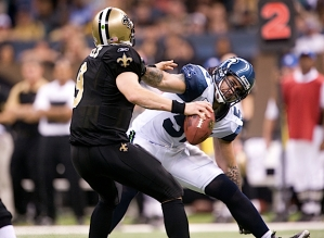 New Orleans quarterback Drew Brees eludes the blitz pressure applied by Seattle linebacker Lofa Tatupu.
