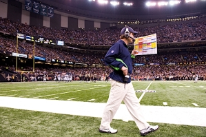 Offensive coordinator Jeremy Bates talks through his headset as he paces the sidelines planning Seattle's offense.