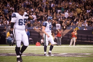 Despite passing for 366 yards against the defending Super Bowl champs, quarterback Matt Hasselbeck walked off the field on the short end of the 34-19 final score. At left is center Chris Spencer.