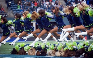 The Sea Gals were flying high during their pregame routine at midfield prior to the introduction of the teams.