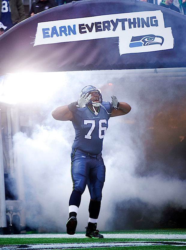 Rookie offensive tackle Russell Okung gets the crowd pumped up as he is introduced during pregame.