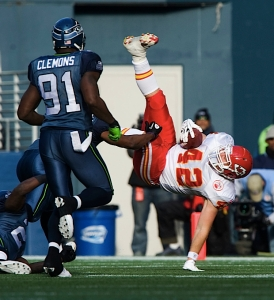 Kansas City tight end Mike Cox tries to steady himself after being upended by Seattle defenders
