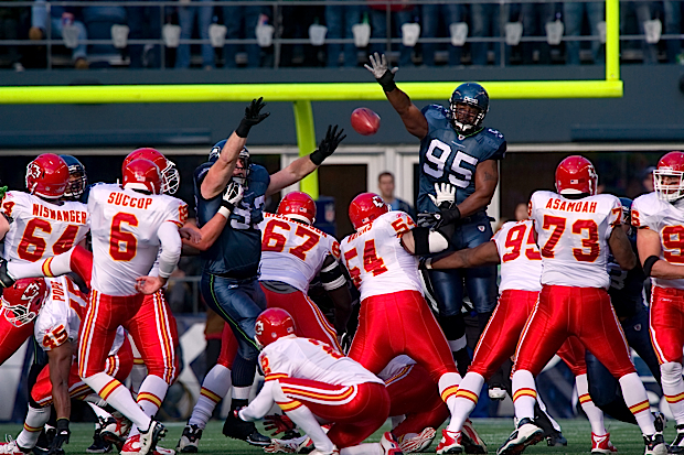 Seattle's Kentwan Ballmer blocks a field goal by Kansas City's Ryan Succop in the first half, one of two big plays by the Seahawks special teams.