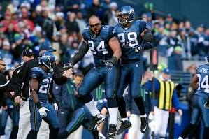 Seattle's Junior Siavii (94) and Raheem Brock (98) celebrate after the Seahawks blocked a Kansas City field goal.