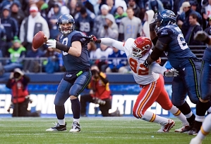 Quarterback Matt Hasselbeck throws while under pressure from Kansas City's Wallace Gilberry (92).