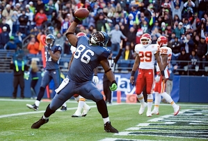 Seahawks tight end Chris Baker spikes the ball emphatically after scoring on a 13-yard touchdown pass from Matt Hasselbeck in the third quarter.