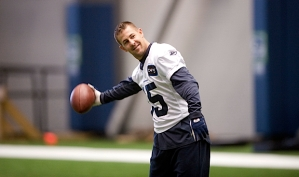 Seahawks receiver Brandon Stokley smiles as he tosses a ball before practice.