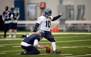Kicker Olindo Mare strikes one through the hold of Jon Ryan.