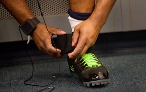 In the locker room hours before kickoff, safety Lawyer Milloy wraps black tape around his shoe and ankle.