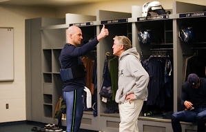Quarterback Matt Hasselbeck and head coach Pete Carroll confer in the locker room before the game.