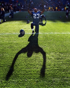 Cornerback Marcus Trufant does his pregame stretching as the low winter sun cast his long shadow across the turf.