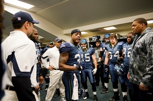 Defensive leader Lawyer Milloy followed injured defensive end Red Bryant (right) with an impassioned pregame speech to the team moments before taking the field.