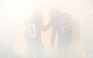 Running backs Justin Forsett and Marshawn Lynch make their way through the fog blanketing the tunnel used in pregame introductions.