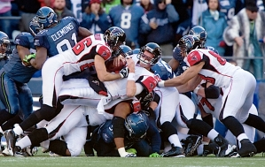 The Seahawks stuff Atlanta quarterback Matt Ryan's sneak attempt on fourth down, but officials ruled for a first down which was upheld after a Seahawks challenge.