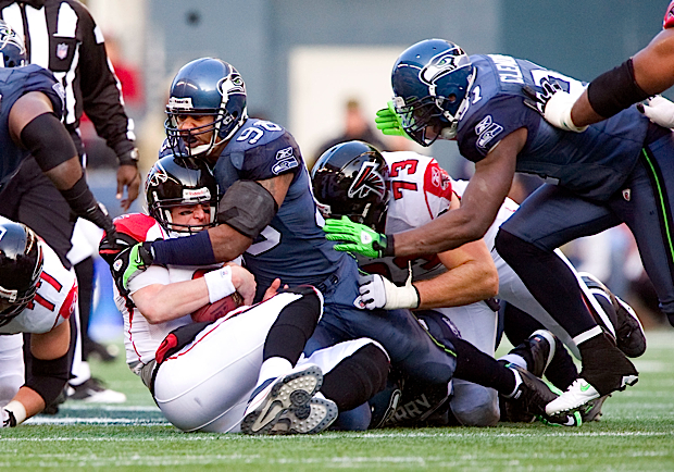 Seahawks linebacker Lofa Tatupu drives Atlanta quarterback Matt Ryan into the turf.
