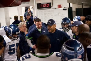 Linebackers coach Ken Norton, Jr. talks the team right before they take the field.