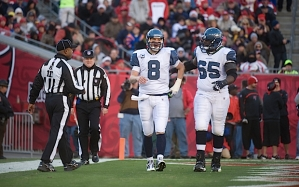 Seattle quarterback Matt Hasselbeck scored on one-yard run, but winced noticeably with an injury as center Chris Spencer came to his aid.