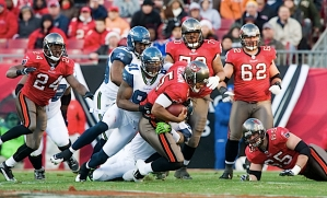 Seahawks defensive end Chris Clemons breaks through for a sack of Tampa Bay's Josh Freeman.