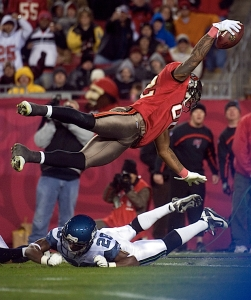 Tampa Bay's Mike Williams sails over Seattle's Walter Thurmond to score on a seven-yard reception in the third quarter.