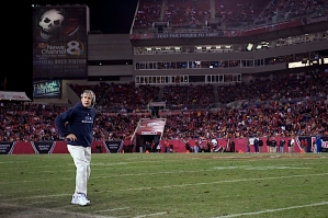 Head coach Pete Carroll stands on the edge of the field in the fourth quarter.