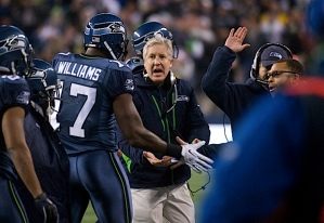 Head coach Pete Carroll congratulates Williams after the touchdown.