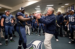 Center Chris Spencer presented the game ball to head coach Pete Carroll, who returned the Seahawks to the top of the NFC West and back to the playoffs in his first season with the team.