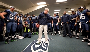 Carroll pauses to collect his thoughts as the team gathered around him in the locker room following the emotional victory.