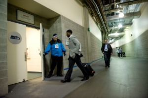 Hours before kickoff, cornerback Marcus Trufant enters the team's locker room at Qwest Field.