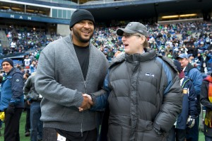 Two recognizable faces of the franchise, future Hall-of-Famer Walter Jones and team owner Paul Allen greet each other on the field before the game.