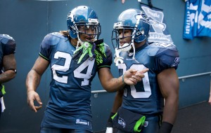 Running backs and best friends Marshawn Lynch and Justin Forsett have a final word before taking the field.