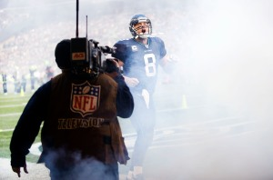 Under always-present eye of network cameras, quarterback Matt Hasselbeck lets out a yell as he's introduced before the game.