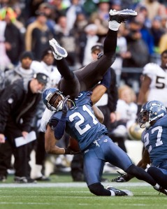 Seahawks cornerback Kelly Kennings upends former teammate and current Saint's running back Julius Jones.
