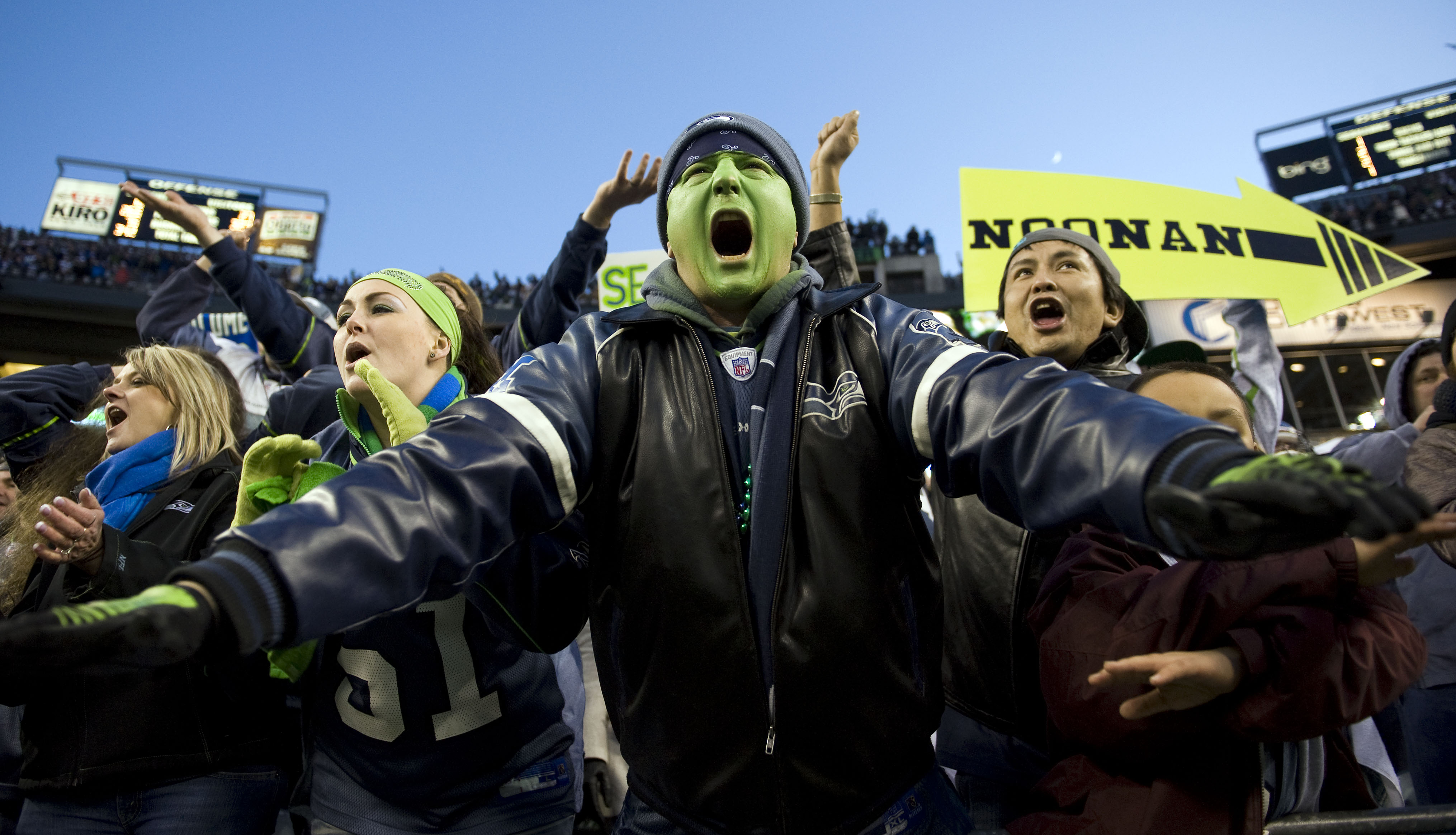 Seattle's 12th Man implores the defense to make a stop during the tense fourth quarter.