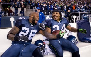 Fullback Michael Robinson and Lynch laugh on the sidelines after Lynch's big run.