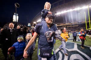 Matt Hasselbeck leads his kids off the field after the win.