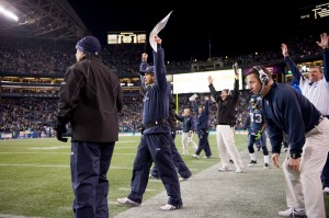 Offensive coordinator Jeremy Bates and fellow assistants celebrate Mare's field goal with gave the Seahawks a 16-6 lead.