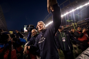 Pete Carroll shakes hands with fans on his way to the locker room.