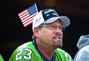 This loyal fan punctuated his Seahawks colors with an American flag.