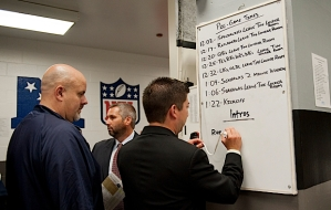 In the locker room, communications manager Rich Gonzales outlined the pregame schedule for the players.