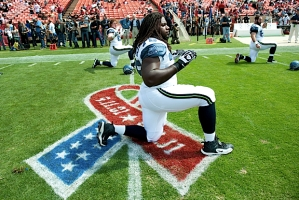 First-round draft choice James Carpenter warms up on the 9/11 logo painted on the field to commemorate the tenth anniversary of the attacks.