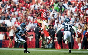 San Francisco receiver Joshua Morgan rose in-between Seahawks defensive backs Kam Chancellor and Marcus Trufant to keep a drive alive in the second half.