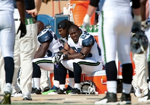 Seahawks running back Justin Forsett sits on the sidelines with teammate Marshawn Lynch as time runs out in the fourth quarter.