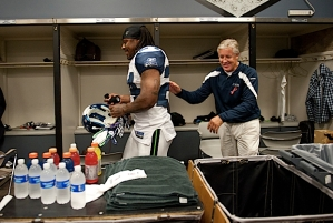 Head coach Pete Carroll made sure he didn't leave the locker room without running back Marshawn Lynch.