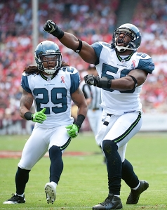 Curry celebrates along with safety Earl Thomas after a first-quarter stop.